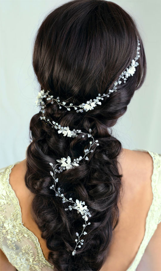 Pearls, handmade flowers, and glass crystals make an elegant vine for bridal or bridesmaids' hairstyle. Scroll to number 11 on the page.