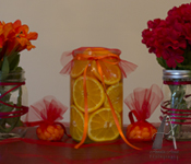 Mason jar flower and fruit centerpiece.