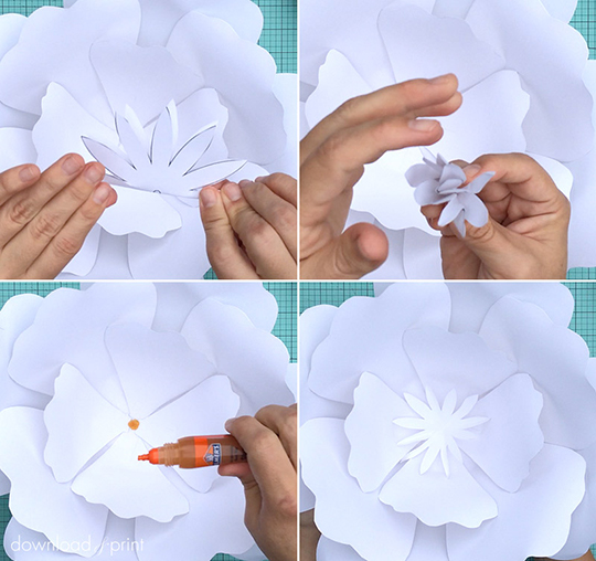 Glue the flower center / stamen on top of the rose petals. Crumple the stamen by folding and unfolding a few times to give it some texture. There is a link to the template, plus a step-by-step tutorial, on the page.