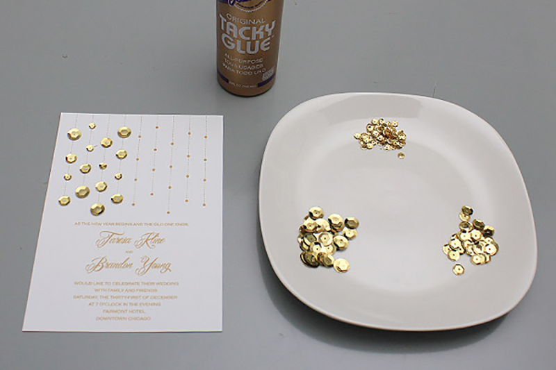 Use different size rhinestones or sequins to bling out wedding invitations.