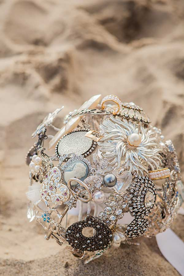 Nontraditional wedding bouquet idea. Budget wedding DIY brooch bouquet...use jewelry from parents and grandparents to make it an heirloom.