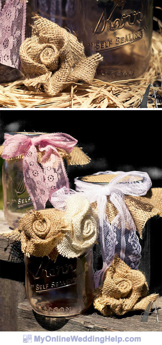 Mason jar centerpieces with burlap roses. The rosettes combined with lace creates a rustic elegant look.