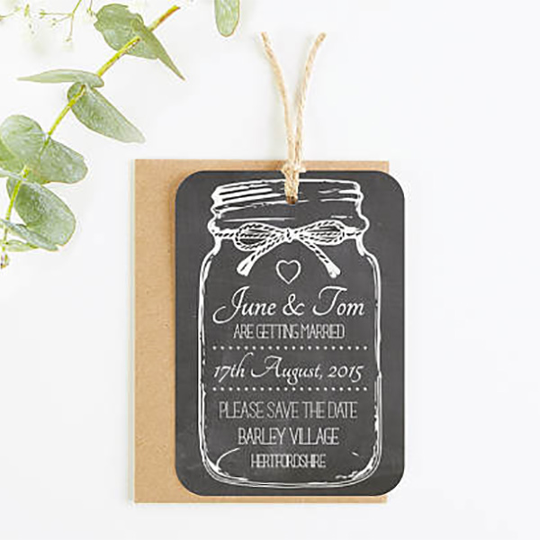 Mason jar shaped rustic wedding invitations. They even come with cute little mason jar shaped RSVP cards. There's a link to purchase in the blog post. Look under number 10. #ChalkboardWeddingInvitations #MasonJarWedding #WeddingInvitationsIdea #BarnWedding #ChalkboardWedding