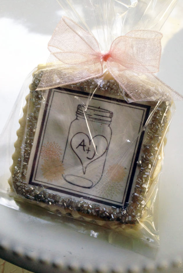 Decorated wedding cookie favors on Etsy. Use them for favors or on dessert tables. Tiffany is amazing! She'll make these personalized cookies in any design you want, and has over 1,000 reviews with solid five stars. There's a link in the blog post to her wedding cookies. Scroll to number 24. #uniqueweddingfavors #cookiefavors #cookiefavors #ediblefavors