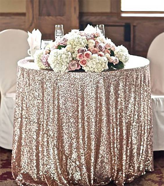Sparkly sequin tablecloths. She makes them in all different sizes and a ton of colors. Nice for wedding reception bling on the guest tables or for the cake table, buffet, and desserts stand. There is a link on the page to buy them. #WeddingDecor #WeddingBling #WeddingDecorations #Tablecloths #TableDecor #EventTables #WeddingTables #SparklyDecorations #SparklyPartyDecor #PartyDecorations