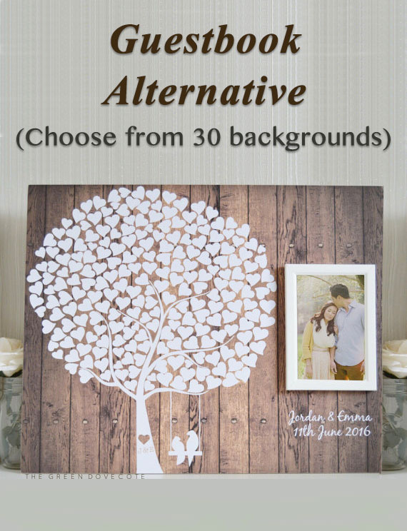Unique rustic wedding guestbook alternative with photo frame. It's wall art after the wedding! So cute. Love birds hanging from a tree with heart shaped leaves. Elegant Country Rustic Wedding Ideas number 12. #RusticWedding #CountryWedding #GuestbookAlternative #MyOnlineWeddingHelp