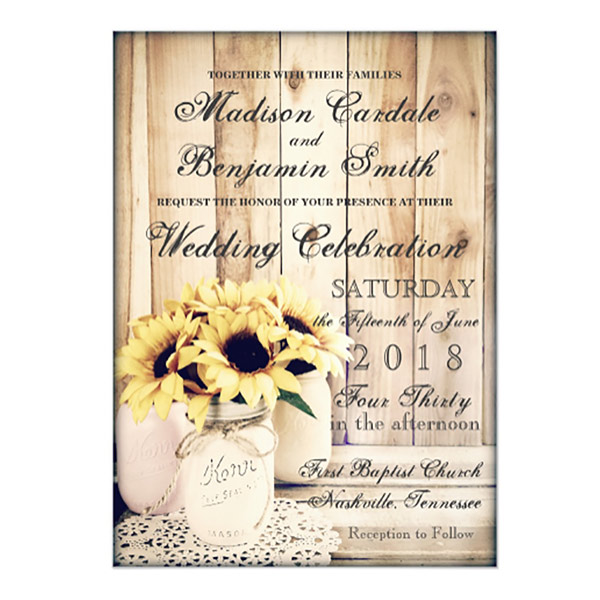 Barn wedding invitation with mason jar flower vase setting on lace. There's a whole collection of envelopes, labels, programs, cards, etc. in this design. There's a link to purchase in the blog post. Look under number 5. #RusticWeddingInvitations #MasonJarWedding #WeddingInvitationsIdea #BarnWedding #CountryWedding