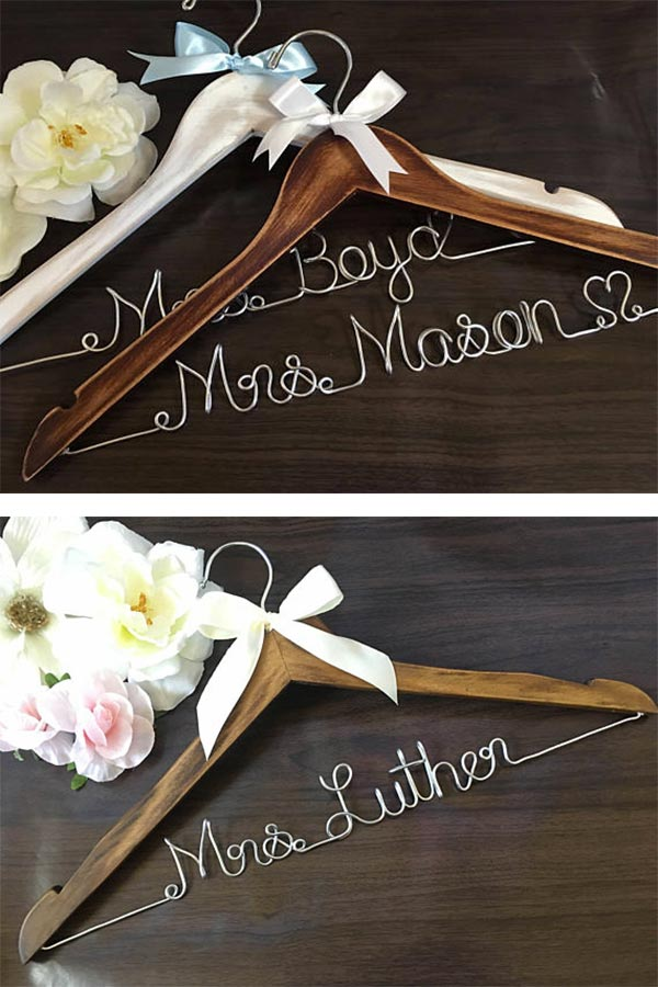 Wooden bride wedding hangers with wire name. Lisa makes these in a choice of 18 different colors. Plus, get at least seven for the whole wedding party and you get a discount. There's a link to them in the blog post. #weddinghanger #bridesmaidshangers #bridesmaidshangers #weddingdresshanger