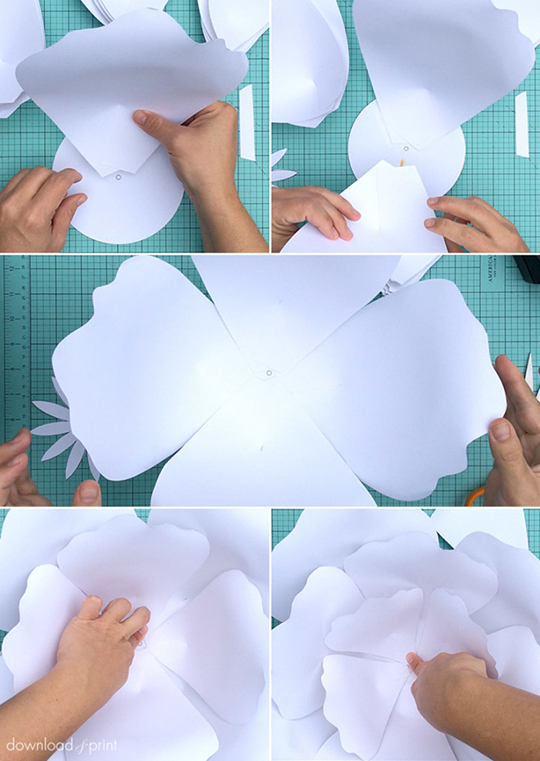 Use tape and/or glue to place paper rose petals to tightly hug the center, staggering smaller petals above the larger. Make sure the curl and printed side are both facing down. There is a link to the template, plus a step-by-step tutorial, on the page.