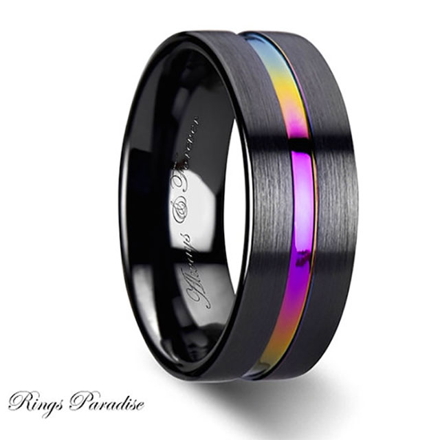 Ceramic rainbow engagement or wedding band. Nice balance of traditional and nontraditional for a gay wedding.