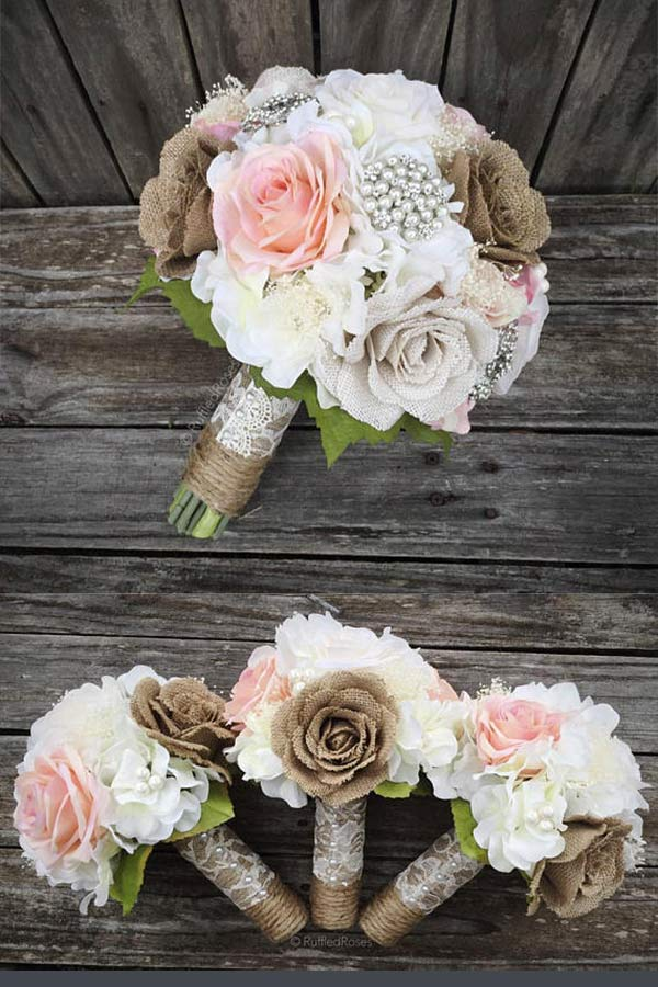 Rustic Burlap Wedding Bouquet with pearls and flowers. The mix of burlap flowers and pearl brooch with lace and twine handle create an elegant bouquet for a rustic country wedding. Look for number 3 on the page for a buy link and info. Elegant Country Rustic Wedding Ideas number 3. #rusticweddingideas #MyOnlineWeddingHelp #countrywedding #rusticbouquet