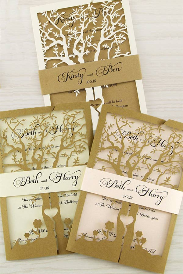 Elegant rustic wedding invitations on kraft paper. These feature a tree with heart cut-out. You can get kraft paper like shown for the laser cut tree and belly band. Or choose other colors. Carol will fully hand make them or simply print and send to you to DIY. Elegant Country Rustic Wedding Ideas number 1. #RusticWeddingInvitations #CountryWeddingInvitations #MyOnlineWeddingHelp #RusticWeddingIdeas #CountryWeddingIdeas