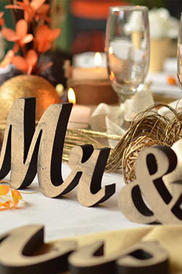 Rustic elegant wooden Mr. and Mrs. signs...maybe hang them on the wall instead of on table? They come in larger sizes, too. (scroll down to number 2 on the page).