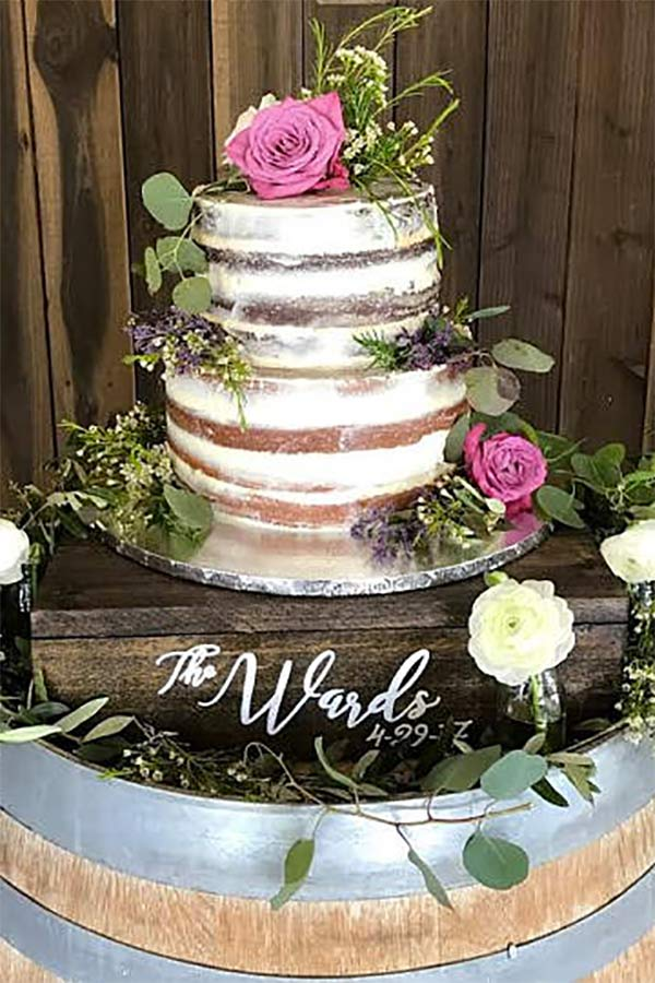 Rustic wood wedding cake stand display box. Decorate with flowers for an elegant or romantic look. Elegant Country Rustic Wedding Ideas number 22. #rusticweddingideas #MyOnlineWeddingHelp #countrywedding #CakeStand
