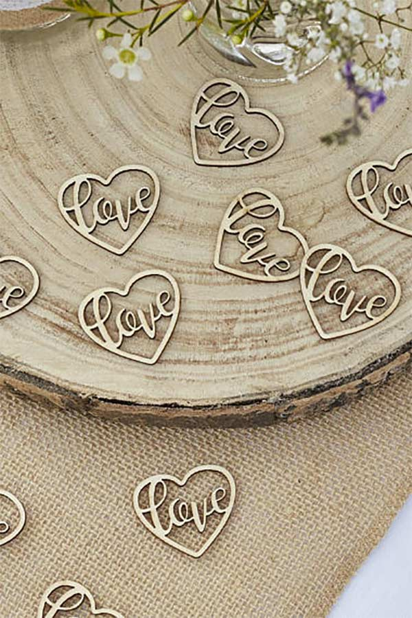 Finish your rustic wedding table decorations with these wooden love hearts table scatter. Look for the burlap table runner and heart log tea light holder to complete the look. Elegant Country Rustic Wedding Ideas number 15-17 on the page. #weddingcandles #RusticWedding #CountryWedding #MyOnlineWeddingHelp
