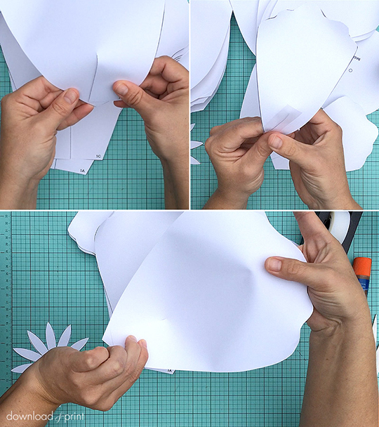 Tips for shaping paper roses: Curl the edges, plus tape the base end so that end flaps cross over each other. There is a link to the template, plus a step-by-step tutorial, on the page.
