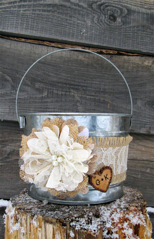 This personalized rustic burlap flower girl basket is actually a galvanized steel bucket. You could also use this as a centerpieces or program holder. Elegant Country Rustic Wedding Ideas number 8. #rusticflowergirl #flowergirlbasket #RusticWedding #BurlapWedding #MyOnlineWeddingHelp