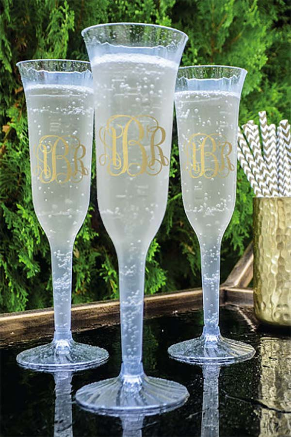 Wedding party favor glasses for guests. These are disposable champagne flutes you can use as favors (fill with treats) or name holders (drop a name card in each). They have margarita glasses, too. There's a link to them in the blog post. Scroll to number 6. #cheapweddingfavors #uniqueweddingfavors #weddingcandlefavors #weddingdrinks