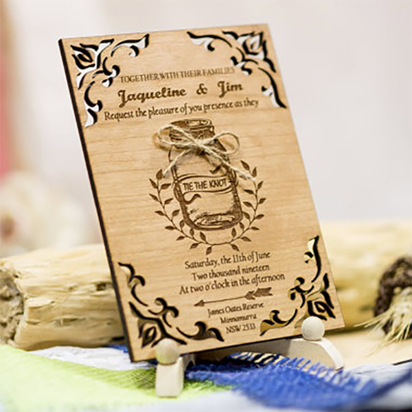 Rustic mason jar wedding invitations made with real wood! She laser cuts these and can make yours from a custom template or idea, too. There's a link to where you can buy it in the blog post. Look under number 1. #RusticWeddingInvitations #MasonJarInvitations #MasonJarWedding #WeddingInvitationsIdea